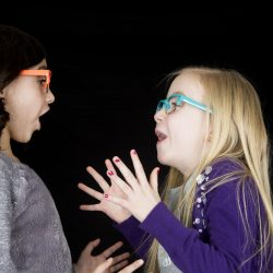 55348836 - adorable girls wearing funky glasses drama expression