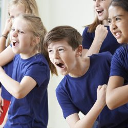 58983973 - group of children enjoying drama class together